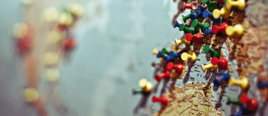 world map with thumb tacks